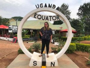 Sarah on the N-S Equator sign in Uganda