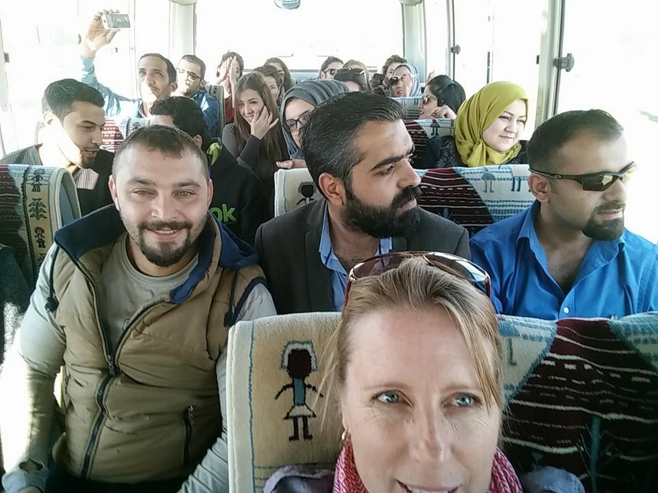 Rachelle Davis on a bus in Iraq with iom enu merators